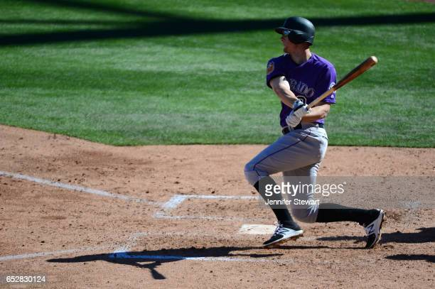 LeMahieu of the Colorado Rockies singles against the Arizona Diamondbacks during the spring training game at Salt River Fields at Talking Stick on...