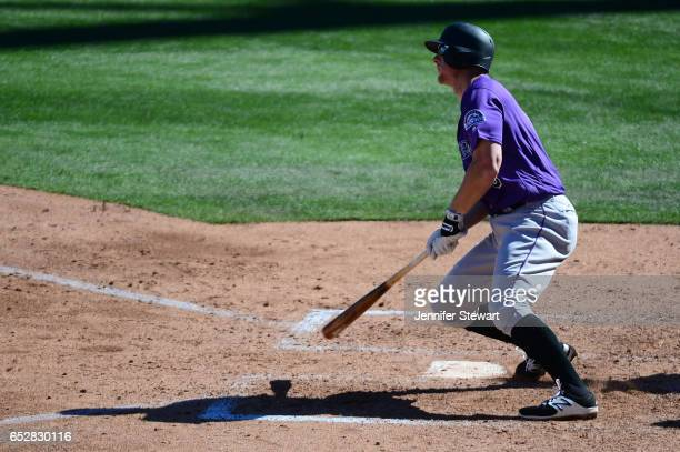 LeMahieu of the Colorado Rockies sinlges against the Arizona Diamondbacks during the spring training game at Salt River Fields at Talking Stick on...