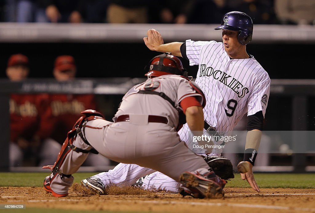 <a gi-track='captionPersonalityLinkClicked' href=/galleries/search?phrase=DJ+LeMahieu&family=editorial&specificpeople=5940806 ng-click='$event.stopPropagation()'>DJ LeMahieu</a> #9 of the Colorado Rockies slides around catcher <a gi-track='captionPersonalityLinkClicked' href=/galleries/search?phrase=Miguel+Montero&family=editorial&specificpeople=836495 ng-click='$event.stopPropagation()'>Miguel Montero</a> #26 of the Arizona Diamondbacks to score on a single by Carlos Gonzalez #5 of the Colorado Rockies off of starting pitcher Brandon McCarthy #32 of the Arizona Diamondbacks to take a 5-4 lead in the fifth inning at Coors Field on April 5, 2014 in Denver, Colorado.