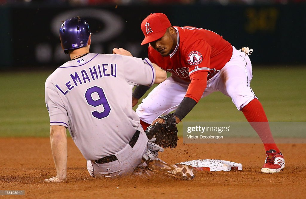 DJ LeMahieu #9 of the Colorado Rockies slides into the tag of Erick Aybar #2 of the Los Angeles Angels of Anaheim in seventh inning during the MLB game at Angel Stadium of Anaheim on May 12, 2015 in Anaheim, California. LeMahieu was caught stealing second. The Angels defeated the Rockies 5-2.