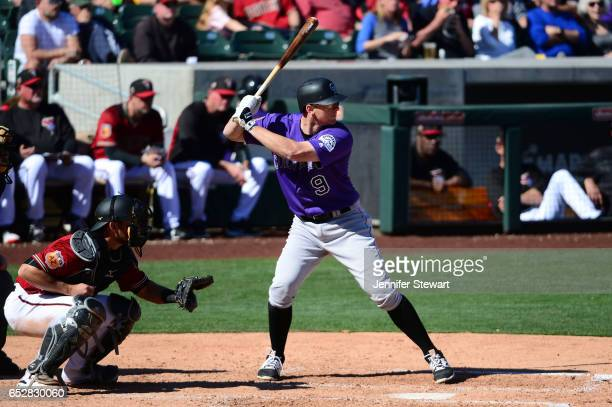LeMahieu of the Colorado Rockies stands at bat against the against the Arizona Diamondbacks during the spring training game at Salt River Fields at...