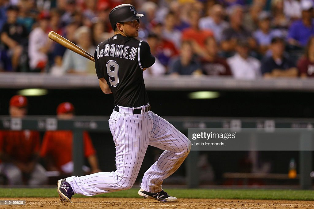 DJ LeMahieu #9 of the Colorado Rockies watches his RBI single during the seventh inning against the Philadelphia Phillies at Coors Field on July 7, 2016 in Denver, Colorado.