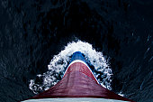 The steel bow of an ice strengthened ecotourism ship ploughs the sea.