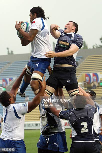Lemalu Faatiga of Samoa and David Morton of Scotland in action during the IRB Junior World Championship Japan 2009 match between Samoa and Scotland...