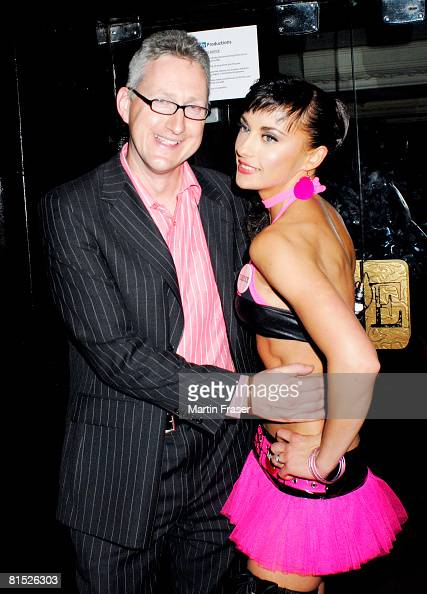 Lembit Opik and Gabriela Irimia of The Cheeky Girl pose at the Embassy Club on June 10 2008 in London England