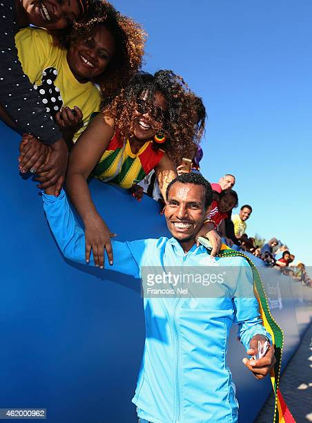 Lemi Berhanu Hayle of Ethiopia celebrates with fans after winning the Men's marathon during the Standard Chartered Dubai Marathon on January 23 2015...