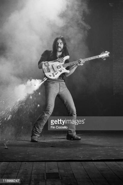 Lemmy Kilmister British rock bassist and singer with British heavy metal band Motorhead poses with his bass guitar with fireworks attached firing...