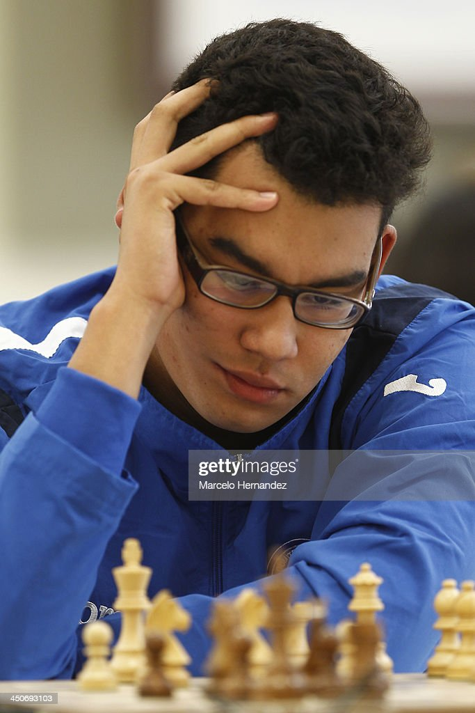 Lemnys Arias of El Salvador competes during the opening day of the Chess competition as part of the XVII Bolivarian Games Trujillo 2013 at Colegio San Jose Library on November 19, 2013 in Lima, Peru.