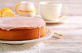 Lemon and yogurt cake with icing on plate
