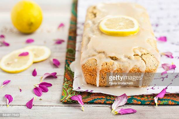 Lemon cake with frosting and lemon