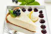 Lemon cheesecake with blueberry sauce