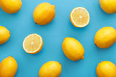 Lemon fruit pattern on turquise background. Repetition concept. Top view