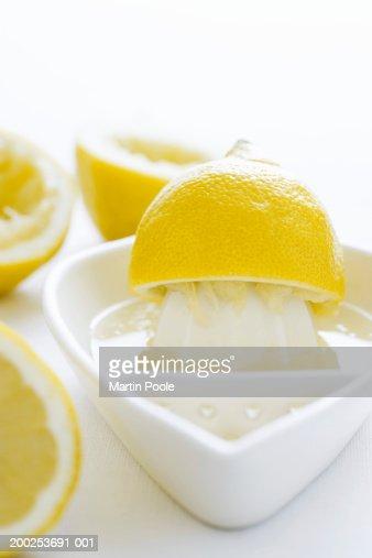 Lemon half and juice squeezer, close-up : Stock Photo