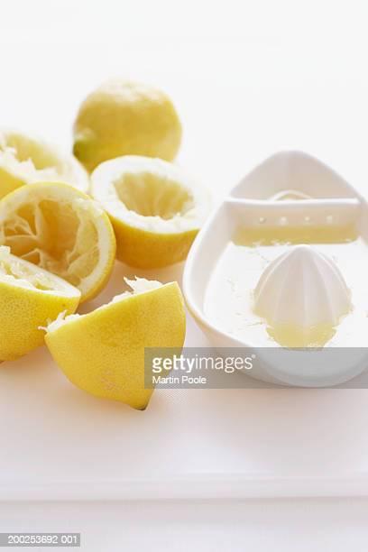 Lemon halves by juice squeezer, close-up