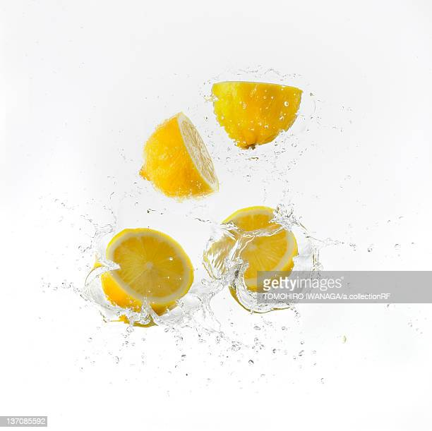 Lemon Halves Falling Into Water