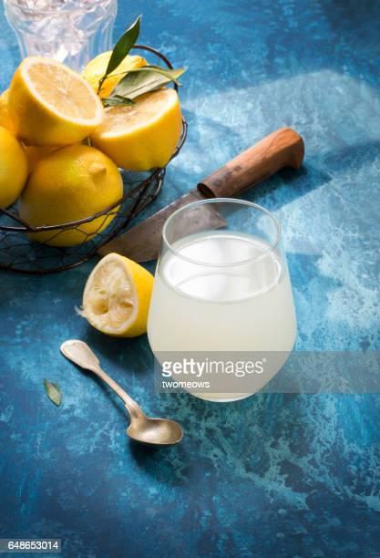 Lemon juice in drinking glass.