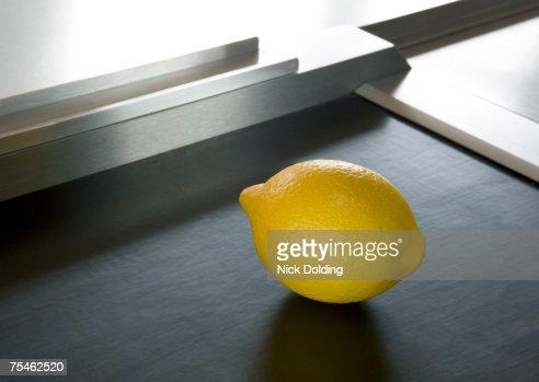 Lemon on supermarket conveyor belt
