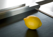 Lemon on supermarket conveyor belt
