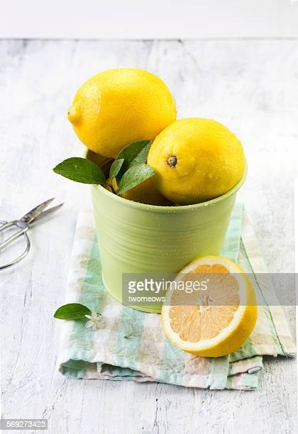 Lemon on white wooden table.