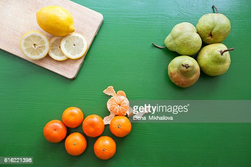 Lemon, pear and tangerine for preparing smoothie : Stock Photo