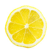 Slice of lemon isolated on white background. The perspective of the image is top view while you can see the seeds through it. It is a bright and clear image with a beautiful yellow.