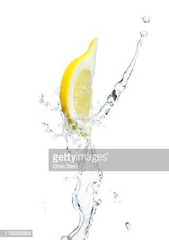 Lemon slice with a splash of water