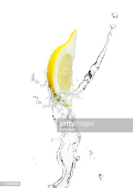Lemon slice with a splash of water