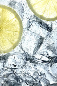 Lemon slices floating in ice and soda
