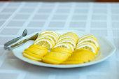 Lemon slices on white plate. Close up shot.