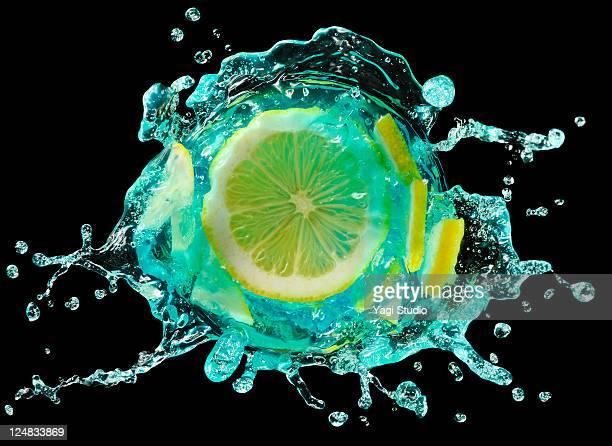 Lemon  splashing into Cocktail, close-up.