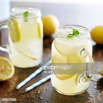 lemonade in jar with ice and mint : Stock Photo
