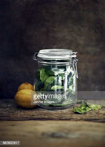 Lemons and lemon leaves in jar