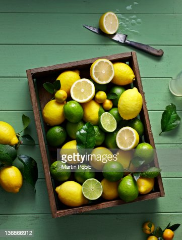 lemons and limes in box overhead : Stock Photo
