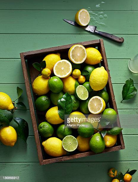 lemons and limes in box overhead