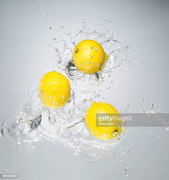 Lemons splashing in to water