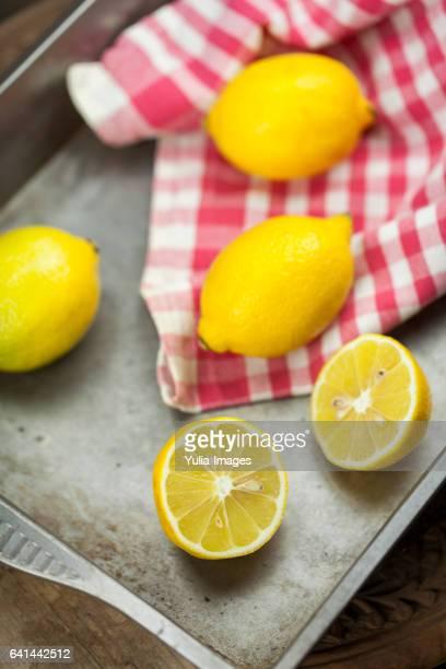 Lemons, whole and cut open