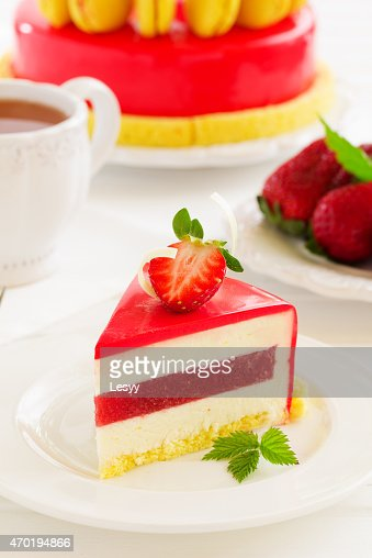 Lemon-strawberry cake with makarons. : Stock Photo