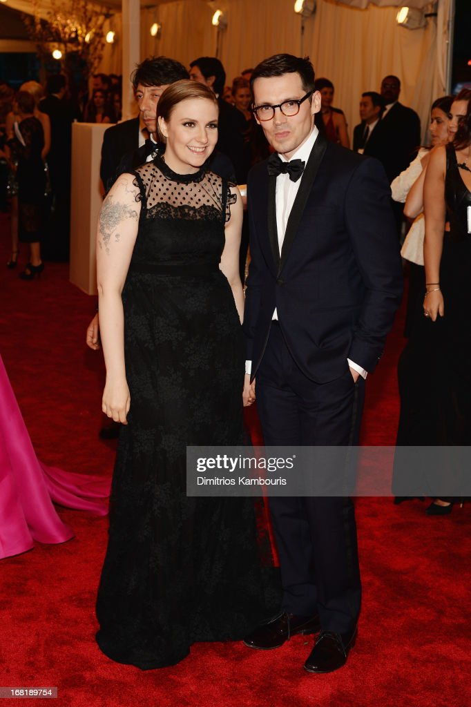 Lena Dunham and Erdem Moralioglu attend the Costume Institute Gala for the 'PUNK: Chaos to Couture' exhibition at the Metropolitan Museum of Art on May 6, 2013 in New York City.