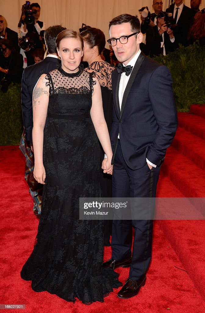 Lena Dunham and Erdem Moralioglu attends the Costume Institute Gala for the 'PUNK: Chaos to Couture' exhibition at the Metropolitan Museum of Art on May 6, 2013 in New York City.