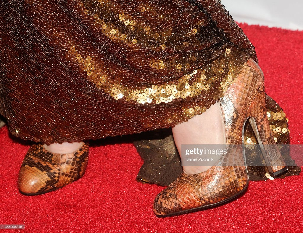 Lena Dunham (shoe detail) attends the 2014 Point Honors New York gala at New York Public Library on April 7, 2014 in New York City.