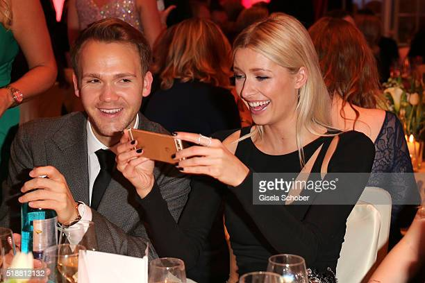 Lena Gercke and her manager Timothy Baines take a selfie during the Gala Spa Awards on April 2 2016 in BadenBaden Germany