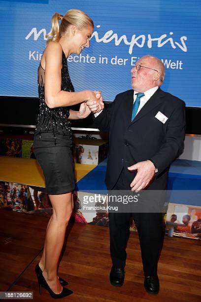 Lena Gercke and Norbert Bluem attend the 15th Media Award By Kindernothilfe at Hauptstadtrepraesentanz Deutsche Telekom AG on November 15 2013 in...