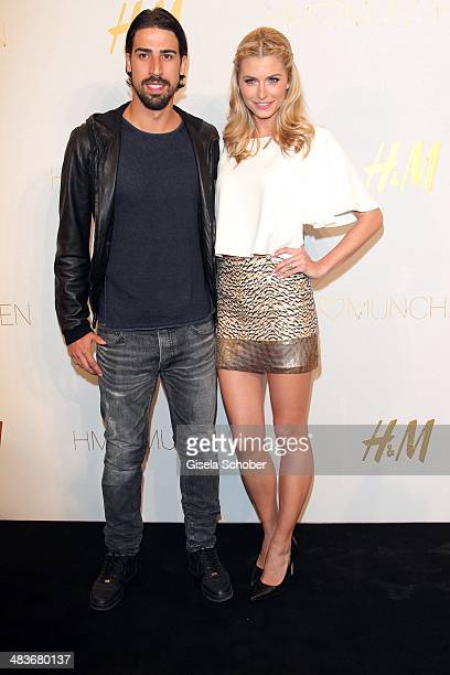 Lena Gercke and Sami Khedira attend the HM store opening on April 9 2014 in Munich Germany