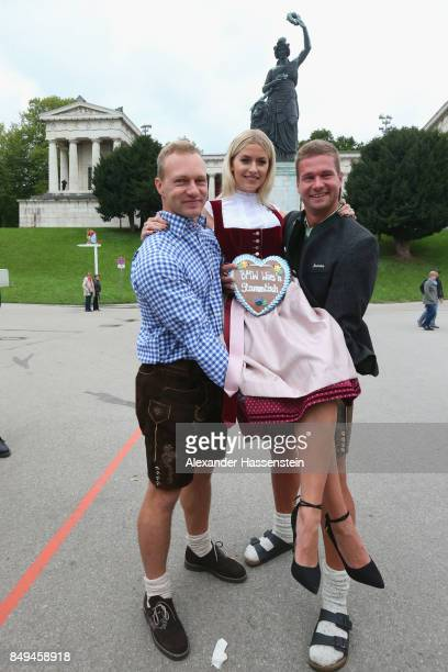 Lena Gercke attends with Francesco Friedrich and Johannes Lochner the BMW Wiesn Stammtisch on September 19 2017 in Munich Germany