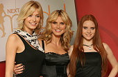 Lena Gercke Heidi Klum and Barbara Meier attend a photocall for PRO7 TV show 'Germanys Next Topmodel' on June 04 2008 at Cologne Germany