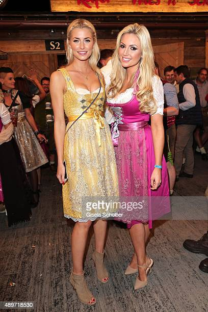 Lena Gercke wearing a Dirndl by the label Alpenprinzessin and Rosanna Davison wearing a pink Dirndl by Alpenmaedel during the 'Beauty Beee' Wiesn...