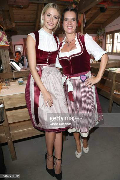 Lena Gercke wearing a red dirndl by 'Amsel Fashion' and Katarina Witt during the 'BMW Wies'n SportStammtisch' as part of the Oktoberfest at...