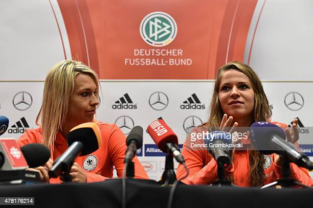 Lena Goessling and Melanie Leupolz of Germany face the media during a press conference at Montreal Convention Centre on June 23 2015 in Montreal...