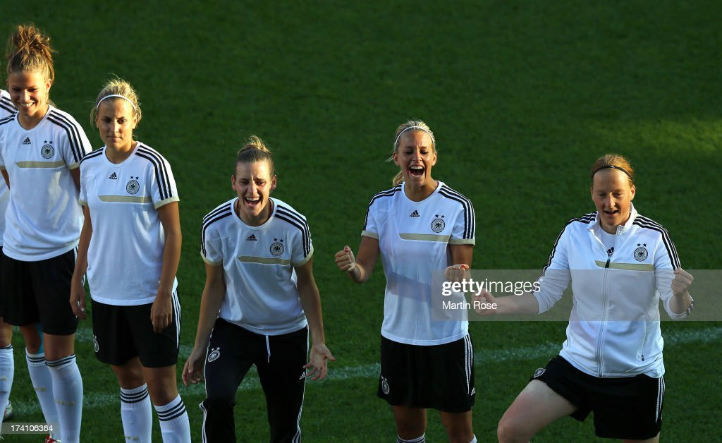 <a gi-track='captionPersonalityLinkClicked' href=/galleries/search?phrase=Lena+Goessling&family=editorial&specificpeople=639252 ng-click='$event.stopPropagation()'>Lena Goessling</a> (2nd R) celebrates during the training session of Germany at Vaxjo Arena on July 20, 2013 in Vaxjo, Sweden.