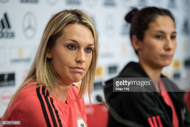 'SHERTOGENBOSCH NETHERLANDS JULY 26 Lena Goessling listens to questions from the media next to Sara Doorsoun during Germany Press Conference on July...